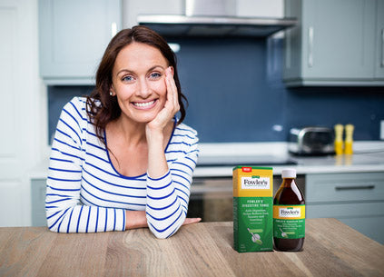 Woman with Digestive Tonic on counter
