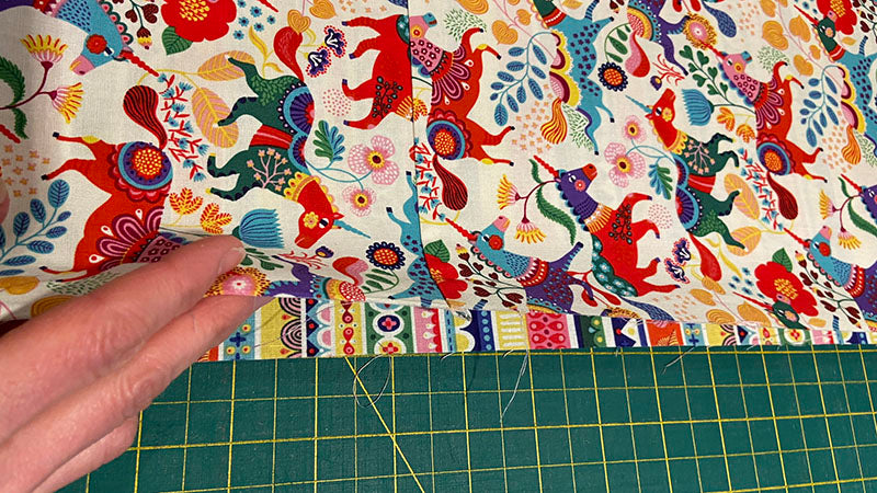 lay the main pillowcase fabric on top of the cuff
