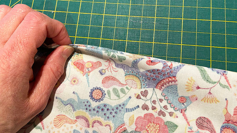 smooth the edges of the pillowcase seams