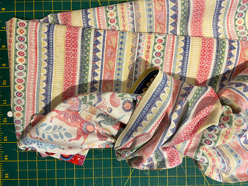 start to pull the pillowcase fabric out of the cuff