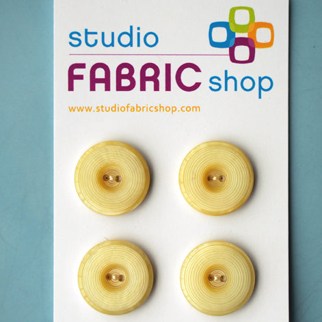 Cream vintage-look textured buttons (23mm)
