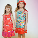 A summer dress and hat made with Fruit Gum fabric in blue by Melody Miller for Cotton + Steel