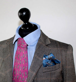 100% Silk Twill Tie in Purple Bird Pattern.