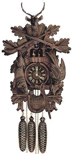 German Cuckoo Clock 8-day-movement Carved-Style 24 inch - Authentic black forest cuckoo clock by Anton Schneider