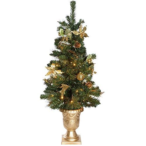 werchristmas 35 ft pre lit potted decorated christmas tree with 42 led lights