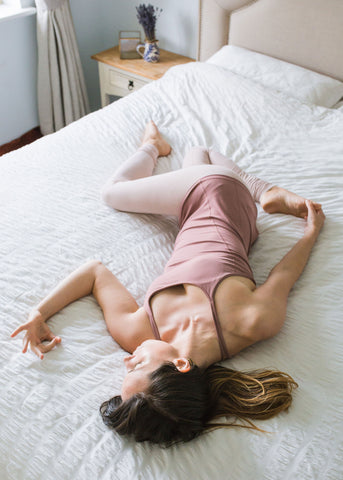 Supine Spinal Twist Yoga Move