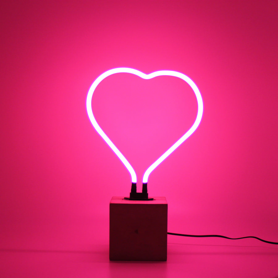 Neon heart with concrete base