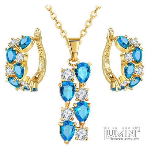 Lumini Brilliant Cerulean Blue Highlights Golden Pendant and Earrings Set: Vines