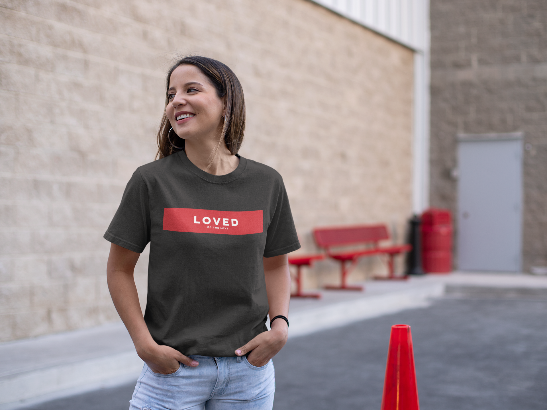 girl wearing CC The Love Loved tee outside department store