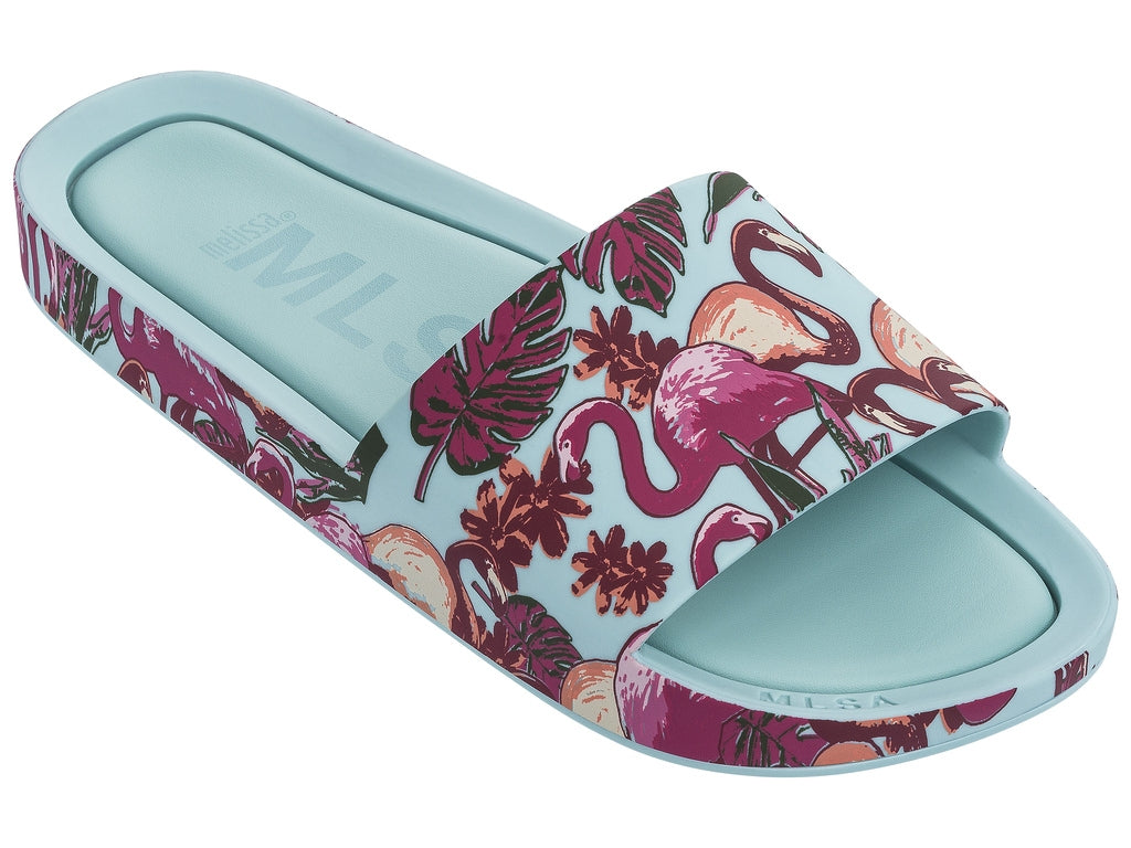 https://4sisters1closet.com/products/melissa-beach-slide-green-pink-flamingos Casually chic slide sandal crafted from fruit-scented PVC. Sold by 4Sisters1Closet