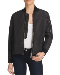 Bomber jacket with high low waist. Pocket detail with zipper. Sold by 4Sisters1Closet