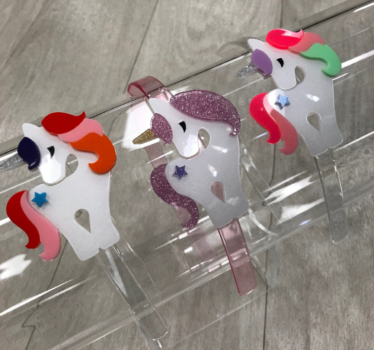 lilies & roses Unicorn Headbands https://4sisters1closet.com/products/lilies-roses-unicorn-headbands Magical unicorn acrylic headbands.