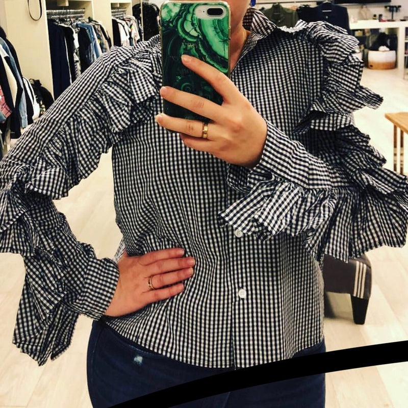 SEN Thrive Top In Black/White Check buttoned down fitted blouse with ruffled detail.