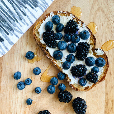 Blueberry and blackberry tartine with ricotta cheese