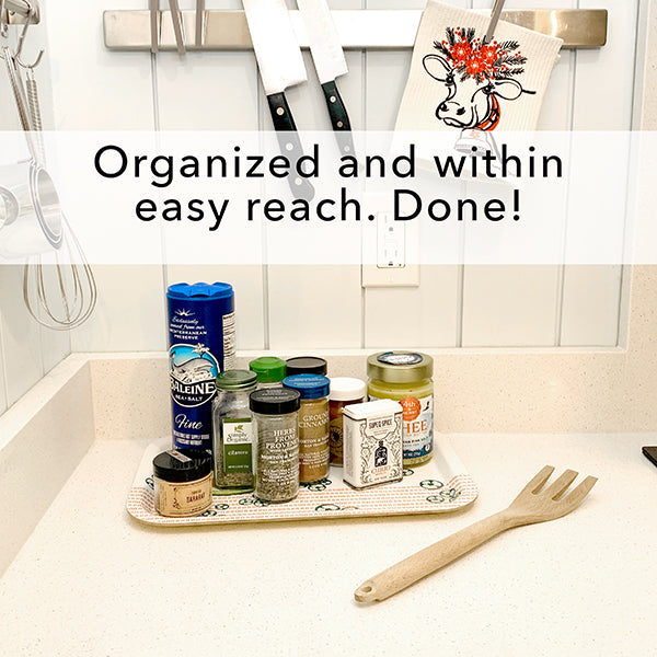 Organize jars of herbs and spices on a tray to keep counter clutter free