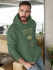 products/pullover-hoodie-mockup-featuring-a-bearded-man-leaning-over-a-sofa-28741.png