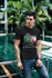 products/t-shirt-mockup-of-a-fashionable-man-posing-by-a-pool-430-el.png