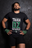 products/t-shirt-mockup-of-an-mma-wrestler-against-a-wall-26255.png