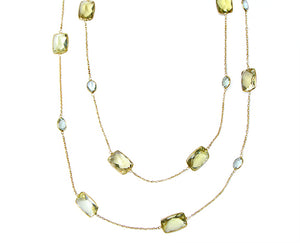 Yellow gold necklace with different shaped gemstones