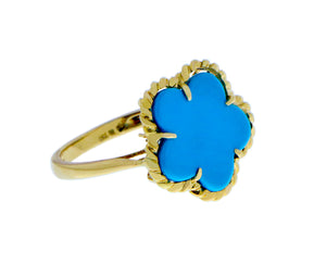 Yellow gold ring with a turquoise flower