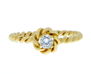 Yellow gold twisted ring with a diamond