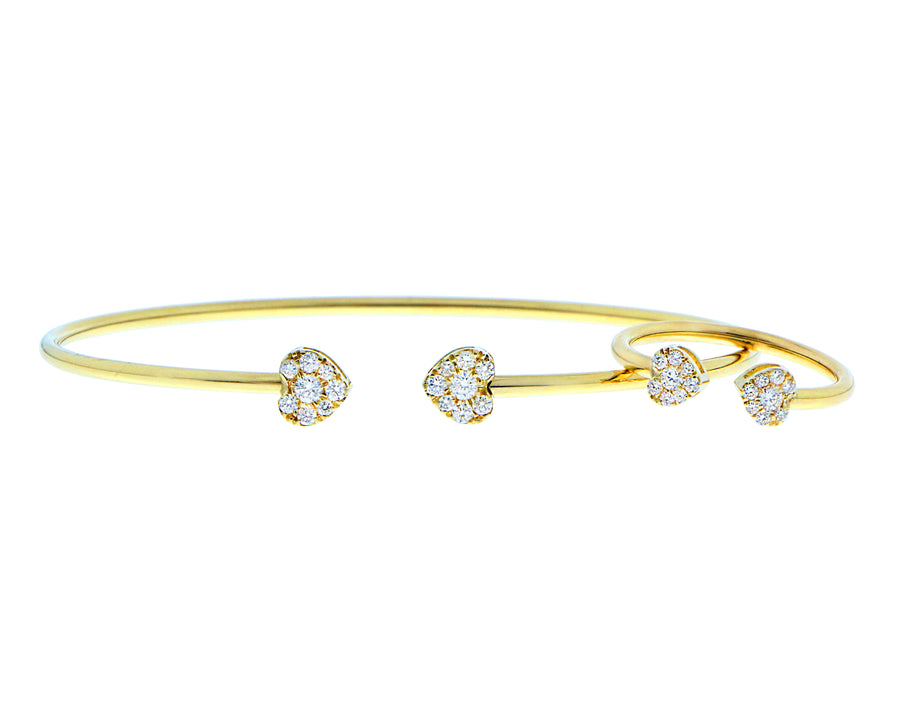 Yellow gold bangle with two diamond hearts