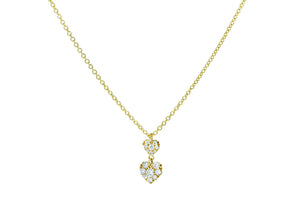 Yellow gold necklace with two diamond heart pendants
