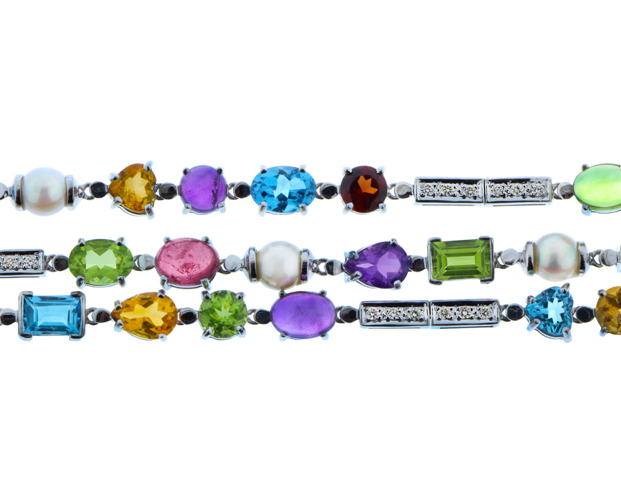 White gold bracelet with diamonds, pearls and a variety of gemstones
