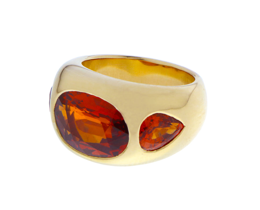 Yellow gold gypsy ring with spessartite garnet