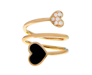 Rose gold ring with an onyx and diamond heart