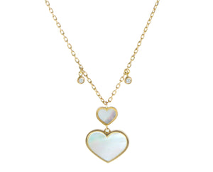 Yellow gold necklace with diamonds and white mother of pearl heart pendants