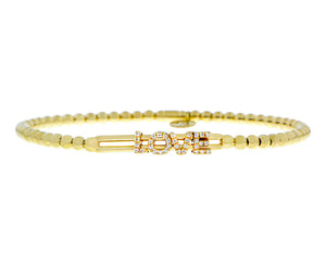 Yellow gold flexible bracelet with diamond letters