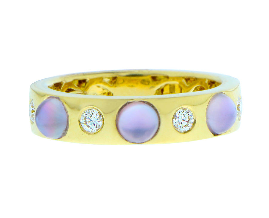 Yellow gold ring with three cabochon cut stones and diamonds