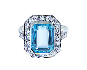 Platinum ring with blue topaz and diamonds