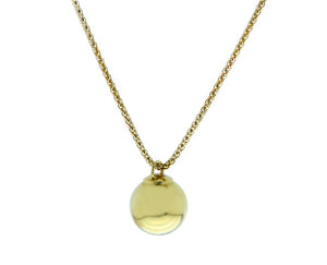 Yellow gold necklace with a gold ball pendant