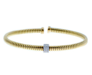 Yellow gold tubo bangle with diamonds