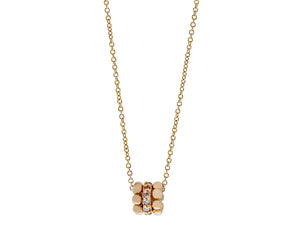 Rose gold and diamond necklace with a three ring pendant