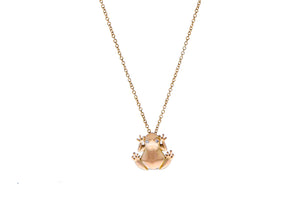 Rose gold necklace with a diamond eyed frog pendant
