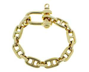 Yellow gold marina link bracelet with a harp closure