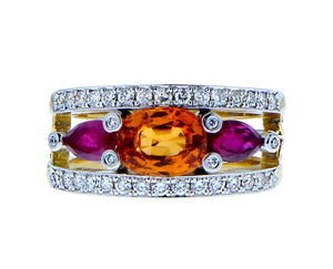 Yellow gold ring with diamonds , an oval spessartite and ruby