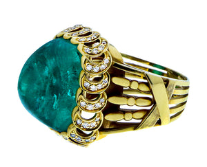 Yellow gold and diamond ring with a cabochon cut emerald