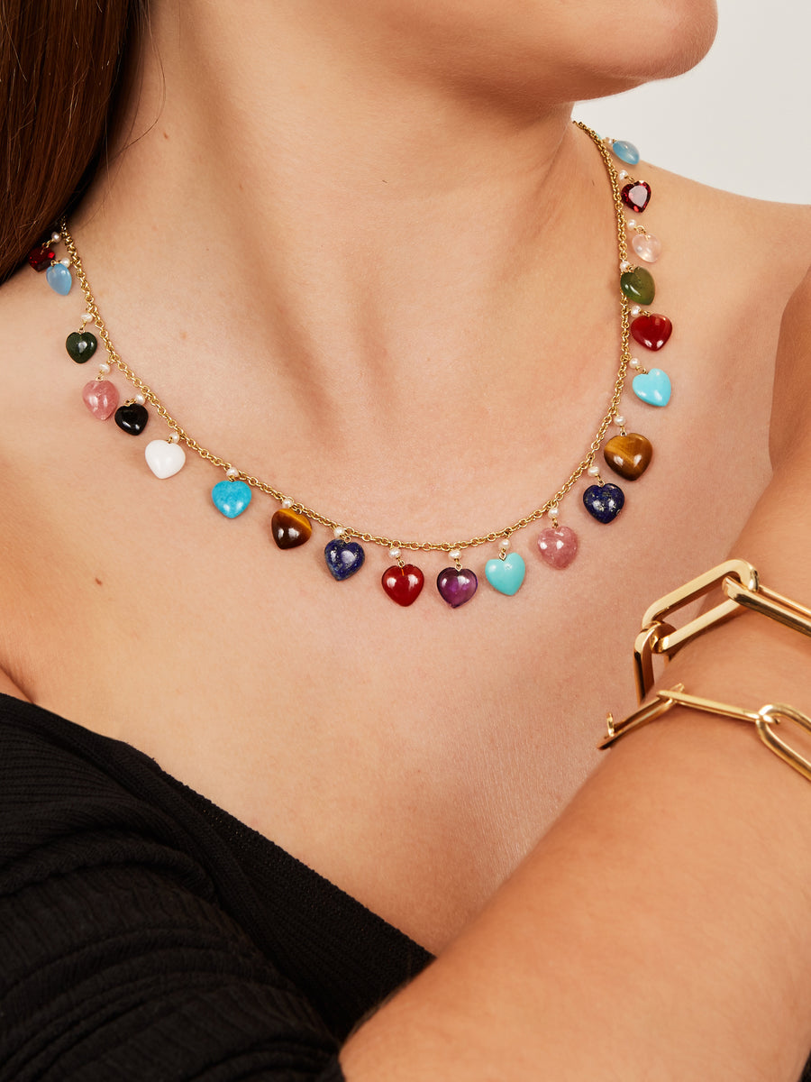 Necklace with heart shaped gemstones