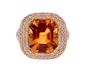 Yellow gold ring with a tourmaline and brown diamonds