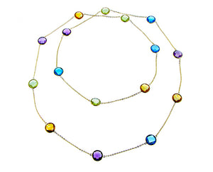 Yellow gold necklace with round shaped gemstones