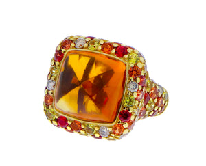Yellow gold ring with a cabochon cut citrine, diamonds and saffires