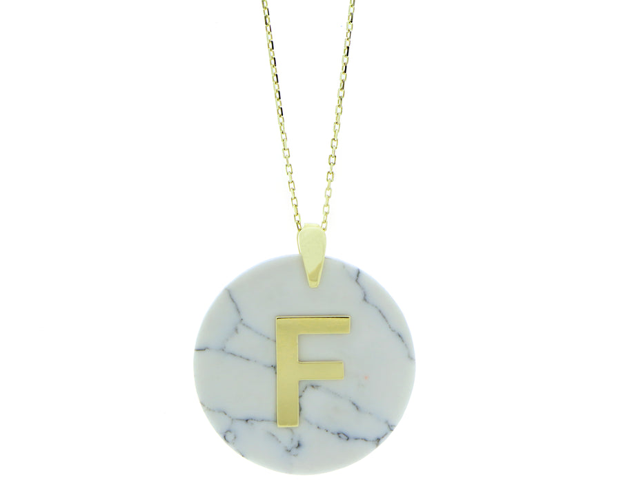 Letter on a colored stone pendant
