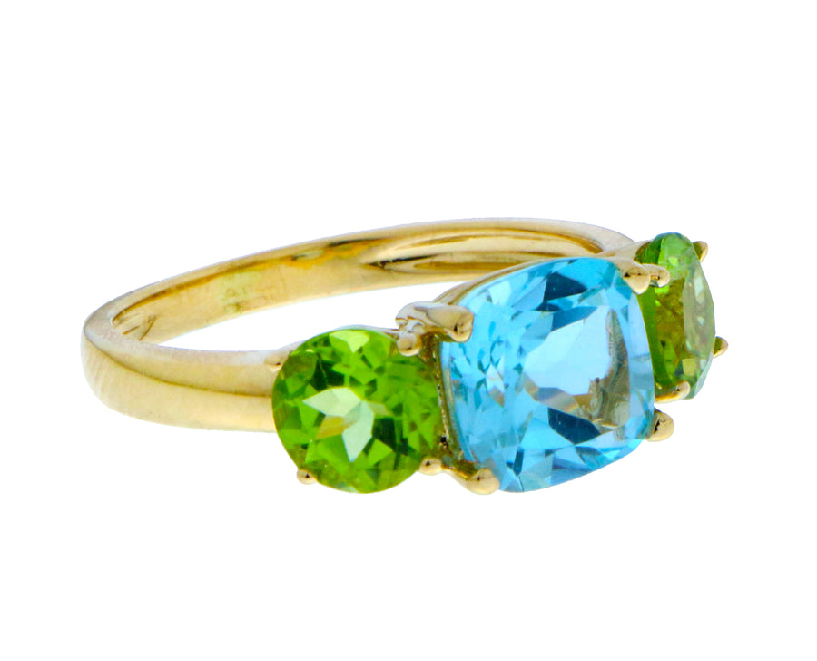 Yellow gold ring with blue topaz and peridot