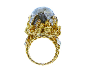 Yellow gold ring diamonds and a rough diamond