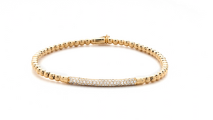 Yellow gold stretch bracelet with diamonds
