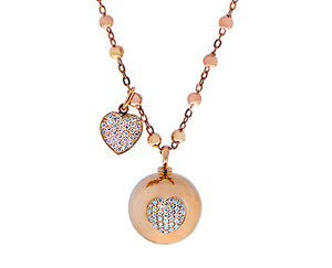 Rose gold necklace with a rose gold ball, a diamond heart and a loose dangling diamond heart